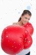 Composite image of portrait of a smiling woman boxing