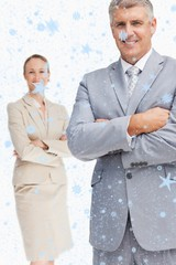Composite image of cheerful business people with folded arms