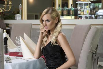 thinking romantic woman at restaurant