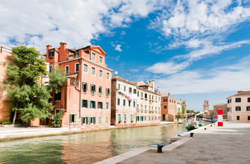 Small canal iwith colorful buildings n the Venice, Italy