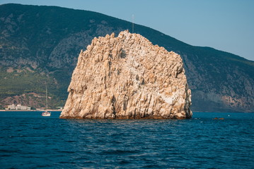 Black Sea landscape with rock and yacht