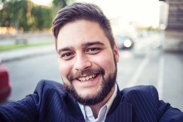 Business man taking selfie