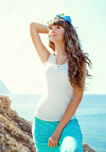canvas print picture portrait of young beautiful woman near the sea