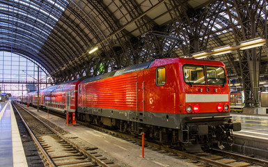 Electric locomotive with regional train in Frankfurt, Germany
