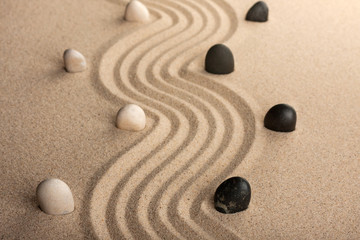 line black and white  stones, standing on the sand