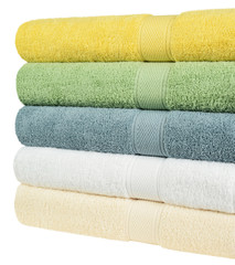 Fluffy towels isolated against white background.