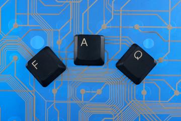 Keyboard keys laid out the word  faq