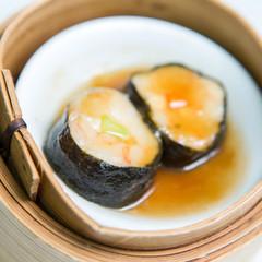Shrimp and seaweed dumplings in a bamboo steamer