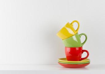Cups on a shelf