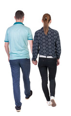 Back view going couple.