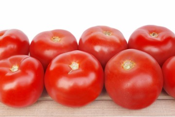 Large tomatoes on the wooden board