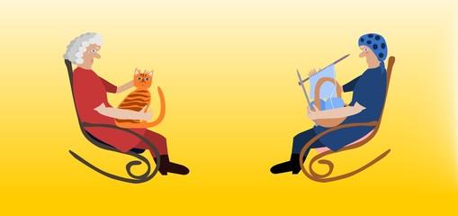 Two elderly women in rocking chairs