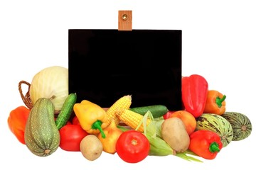 Chalkboard is surrounded by Vegetables
