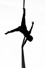 acrobatic woman dancer yoga on aerial silk, aerial contortion © avarand