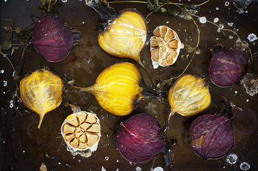 Roasted beetroots and garlic on a baking tray