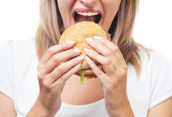 girl eating burger on white background