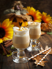 Pumpkin spice latte with whipped cream and caramel