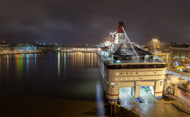 The moored ferry at the mooring at night