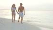 Romantic Couple Walking On Beautiful Tropical Beach