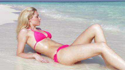Woman In Bikini Relaxing On Beautiful Tropical Beach