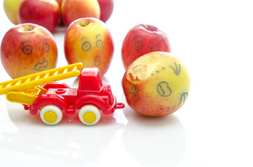 Red apple and toy car