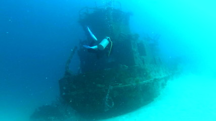 Diver Exploring Sunken Boat
