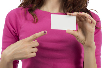 Woman pointing to a sign card with copyspace