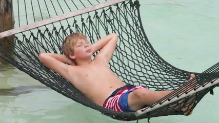 Boy Relaxing In Beach Hammock
