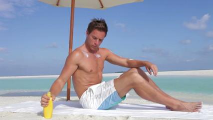 Man Applying Sun Lotion On Beach Holiday