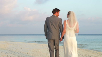 Rear View Of Couple At Beautiful Beach Wedding