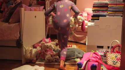 Time-Lapse Sequence Of Girl Moving Toys To Make Bed On Floor