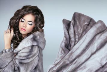Beautiful fashion woman in mink fur coat. Winter girl in luxurio