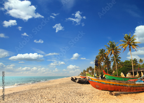 Foto op Canvas India old fishing boats on beach in india