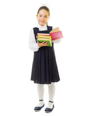 Little smiling schoolgirl with books