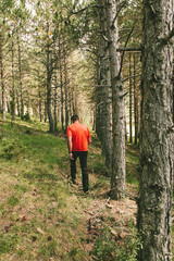 Man Having a Walk in the Forest