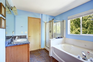 Very bright bathroom in light blue color