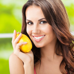 Young happy smiling woman with limon, outdoor