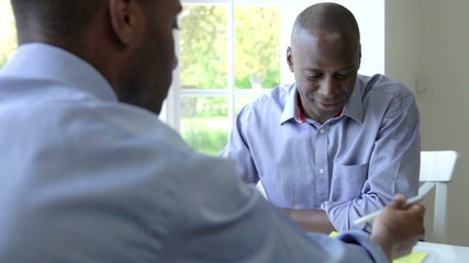 Mature Black Male Meeting With Financial Advisor At Home