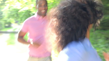 Young African American Couple Running Along Country Path