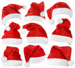 Set of red Santa Claus hats isolated on white background - 69777404