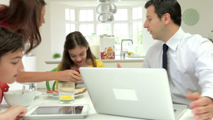 Family Argument Over Digital Devices At Breakfast Table