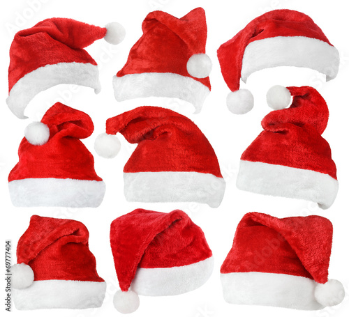 canvas print picture Set of red Santa Claus hats isolated on white background
