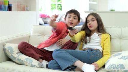 Two Hispanic Children Arguing Over TV Remote Control