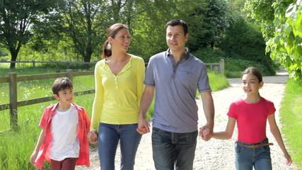 Hispanic Family Walking In Countryside