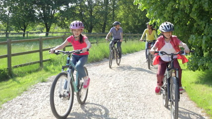 Hispanic Family On Cycle Ride In Countryside