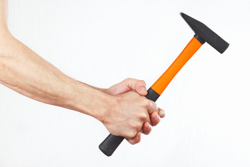 Hands holding a hammer on a white background