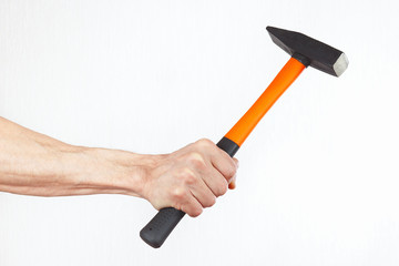 Hand of a carpenter with a hammer on a white background