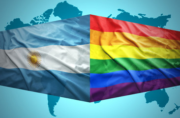 Waving Argentinean and Gay flags