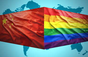 Waving Chinese and Gay flags