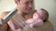 Постер, плакат: Slow Motion Sequence Of Father Taking Shower With Baby